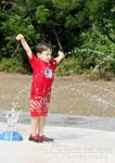 Little boy cooling down at Frisco Commons