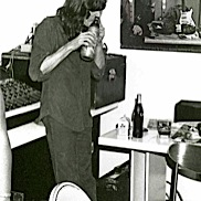 John Cipollina snorting a Coke bottle